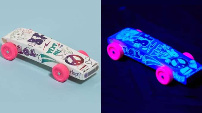Next big thing in Pinewood Derby racing: black lights and glow-in-the-dark cars