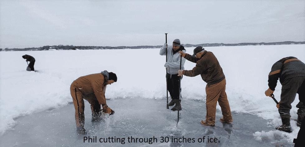 Phil cutting through 30 inches of ice